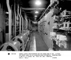 General Electric motor-generator sets for furnace rows at left.  At right are control panels for...