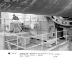 Electrical engineer inspects drive motor mechanism for #4 kiln. Universal Atlas Cement Co.,...