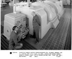 Close-up of General Electric turbine-generator unit, 22,000 kW, 3600 RPM, with C.J. Blasing, supt....