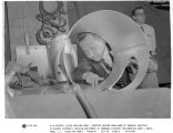 A. LoDestro, chief welding engineer, inspects welded seam made by General Electric fillerarc...