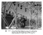 (L-R) R.N. Rouse, substation foreman, GSU Co., and W.C. Travis, General Electric Co., shown in...