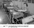 Left to Right Marietta bates, Agnes Pearson, Miss C.M. Walliman operating automatic bookkeeping...