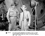 Bill Mittry of Mittry Constructors of Los Angeles, R, and J.R. Dillman, G-E sales engineer stand...