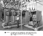 C.A. Pearsall, ass't supv. Bradenton Dist. inspects three General Electric ML-32 volt. Reg's at...
