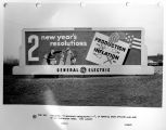 "Billboard; ""2 New Year's Resolutions"" Production yes, Inflation no, on memorial green..."