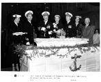 Captain Robert Joseph Stroh of USS Saratoga cuts ceremonial cake following commissioning of...
