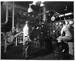 """""Talkers"""" in touch w/ the main control room as workers check gauges on the..."