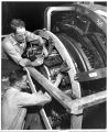 John Ellis and Lealon Wimpee, test men at Schenectady Works, placing and adjusting brushes on a...