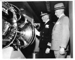 "Admiral Krendall and Mr. Littlejohn view J-47 cutaway aboard """"Apparatus..."