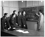 Air Force non-commissioned officers receive special training under the direction of Frank J....