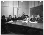 Air Force non-commissioned officers seated at a seminar table under the direction of Frank J....