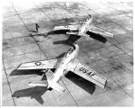 Airmen at Otis Air Force Base, Massachusetts, spot two F-86 fighters to demonstrate proper...
