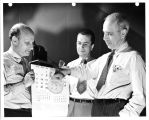 Dr. Lewis R. Koller (left), Donald A. Cusano and Dr. Frank J Studer demonstrate the transparency...