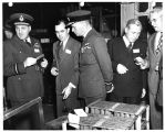 Compressor blades of the General Electric J-47 engine are explained to British visitor D.D. Streid...