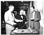 Chief marsh is briefed on remote control wiring by General Electric's R.L. Carson, (left) and G.H....
