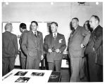 Inspecting the General Electric Company's Lockland Ohio turbojet center are (left to right) C.W....