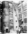 Bridgeport CT - This huge, 70 foot waste chute, weighing 30 tons, is shown being dismantled as...