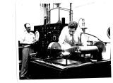 A blinding, ear-splitting machine at the General Electric Research Laboratory is prepared for its...