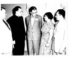 A.D. Marshall, center, General Electric Company manager of employees benefits, chats with four...