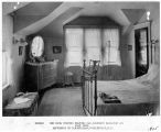 Bedroom showing heating pad, luminous radiator and flat iron. Residence of H.W. Hillman,...
