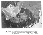 The assembled generator rotor being lowered into the stator; Glen Canyon Powerhouse.  (8) ATI-W-48...