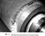 Rotor damaged during shipment to Schenectady. Close-up view showing punching damage at end of...