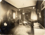Cowles Hall Parlor, piano, fire in fireplace