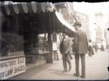 New York City street scene with men in front of store