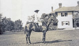 Martha Blow Wadsworth posing with one of her horses at Ashantee