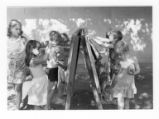 "Children painting in ""Paint Pen"" during the Clothesline Festival, Sept. 1980"