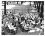 Children painting in Creative Workshop Class on back lawn of Memorial Art Gallery Summer 1940s or...