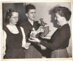 Gertrude Herdle Moore admiring clay models by Creative Workshop Students ca. late 1940s early 1950s