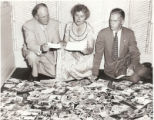 Gertrude Herdle Moore between W. Charles Marshall, Central Trust V.P. & Fred Powers, Chief...