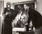 Gertrude Herdle Moore and Charles Bridgman, Kodak Radiologist examining x-ray of painting 1950s