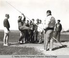 Track clinic for high schools, Ithaca College, Ithaca, NY, group photograph at track, taken April...