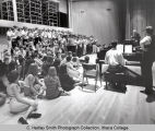 Chorus rehearsal, Leopold Stokowski conducting, group picture, Ford Hall, Ithaca College, Ithaca,...