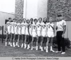 Men's cross country team, Ithaca College, Ithaca, NY, group photograph outside Hill Center, taken...