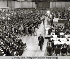 Commencement (graduation) ceremony, Nelson Rockefeller speaking, protestors leaving at left, Hill...