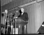 Mid-Century Convocation, close view of George E. Stringfellow speaking,  Ithaca College, Ithaca,...