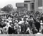 Commencement attendees outside Hill Center after ceremony, Ithaca College, Ithaca, NY, exterior...