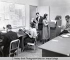 Radio-tv newsroom, students preparing for broadcasts, Ithaca College, Ithaca, NY, interior group...