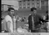 Spring Egbert Union  picnic beverages, close view of 2 students with picnic area in...