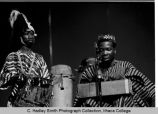 Olatunji & group members playing, close view onstage in Ben Light Gym, Ithaca College, Ithaca,...