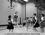 Women's basketball game, Ithaca College, Ithaca, NY, close action photograph in College Gym, taken...