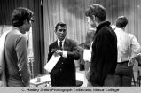 Rod Serling in conversation with College students during Communications Symposium, close group...