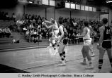 Mens' basketball game vs. Hartwick, players struggle for ball, action picture in Ben Light Gym,...