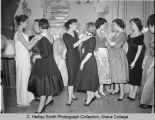 Sororority sisters preparing for party, Ithaca College, Ithaca, NY, group picture taken February...
