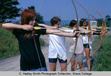 Archery practice, Ithaca College, Ithaca, NY, exterior group view taken June 1970.