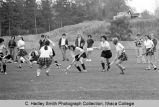 Field hockey game, Ithaca (dark skirts) vs. Brockport, Ithaca College, Ithaca, NY, action picture...