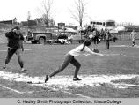 Softball game, Ithaca College women vs. Albany, action picture of Ithaca player (dark shirt)...